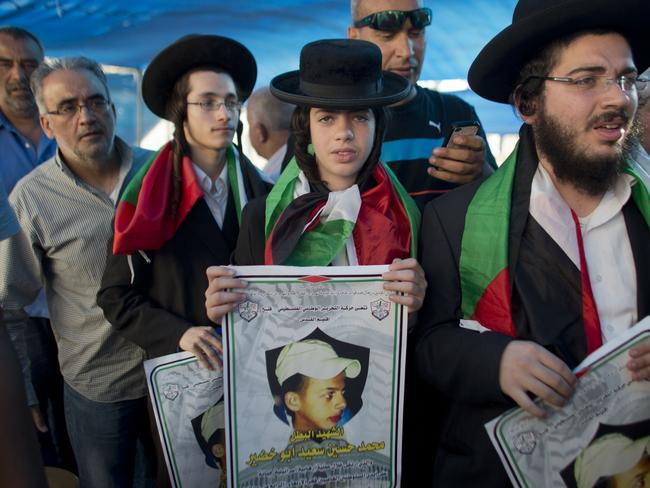 Jewish support ... Members of Neturei Karta, a small faction of anti-Zionist ultra-Orthodox Jews who oppose Israel's existence, hold pictures of Palestinian youth Mohammed Abu Khder. Picture: Ahmad Gharabli