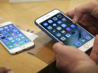 FILE - In this Friday, Sept. 16, 2016, file photo, a customer sets up his new iPhone 7 Plus, right, as he switches from the iPhone 6 at the Apple Store on Michigan Avenue during the release of the Apple iPhone 7 and the latest Apple Watches, in Chicago. New documents from WikiLeaks, posted Thursday, March 23, 2017, point to an apparent CIA program to hack Apple's iPhones and Mac computers such that the exploits persist even after the devices are reset to factory conditions. Security experts say the exploits are plausible, but they are playing down the threat to typical users. The techniques typically require physical access to devices, something the CIA would only use for individuals it is targeting. (AP Photo/Kiichiro Sato, File)