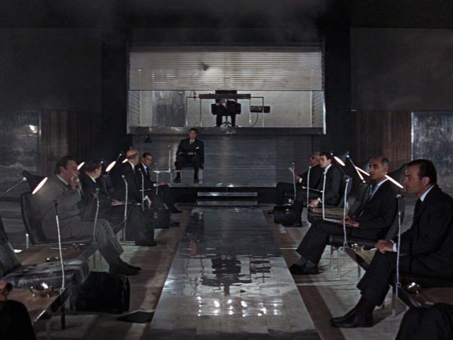 SPECTRE ... The long table is there. So too are the phones and microphones. The only thing missing from SPECTRE's briefing room from Thunderball are the lace curtains and white-wall panels.