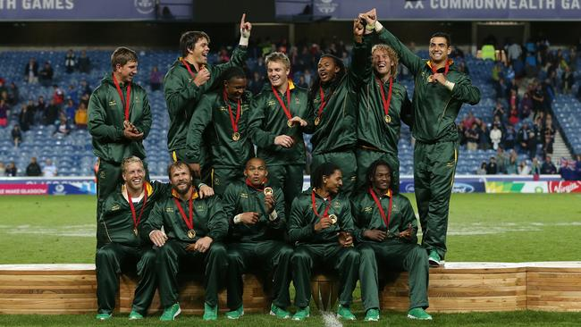 The South African team celebrates with winning the rugby sevens gold medal at the Commonwealth Games in Glasgow.