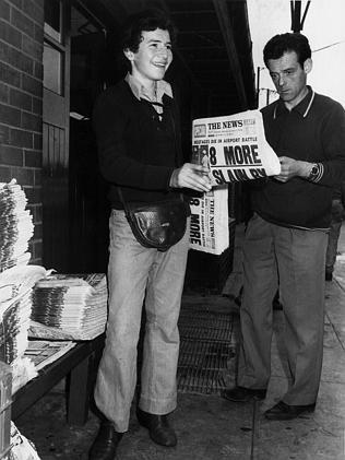 A paperboy sells a copy of The News in 1972.