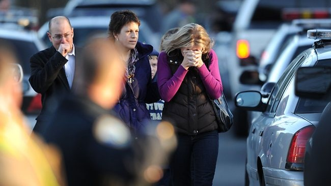 Residents grieve following a shooting at Sandy Hook Elementary School on December 14, 2012 in Newtown, Connecticut. Picture: AFP