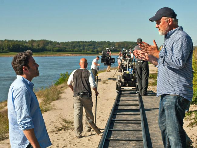 Ben Affleck, left, rehearses a scene with director David Fincher on the set of Gone Girl.