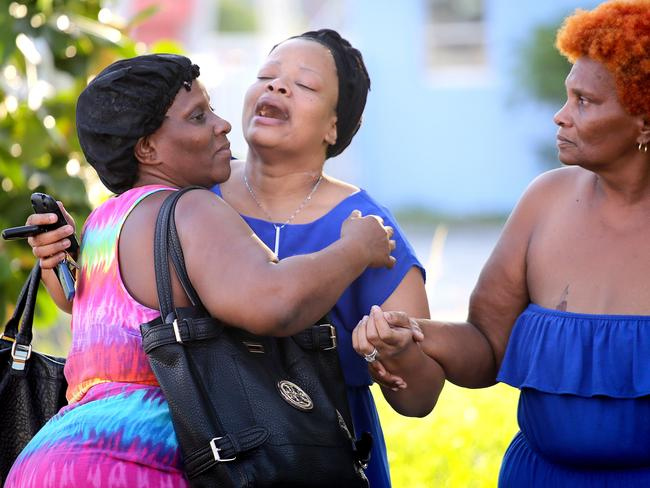 Grief ... Bennae Robinson (C), aunt of shooting victim Kevin Richardson, 30, reacts to his death, after two gunmen opened fire on a Miami complex. Picture: AFP
