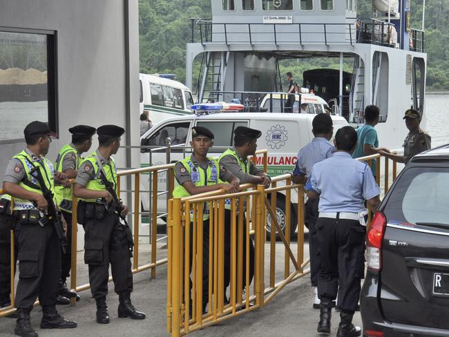 Preparations ... Armed police officers and security personnel stand guard as a ferry carrying ambulances prepares to set off for Nusa Kambangan island where the executions of the five of six drug convicts were performed.