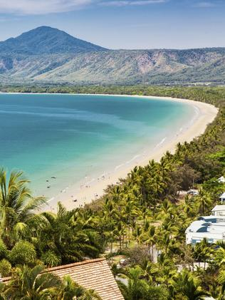 ... with picture-perfect Port Douglas, a bit further north. Picture: mvaligursky