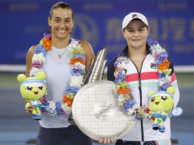 Caroline Garcia (L) and Ash Barty after the Wuhan final.