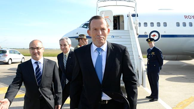 Hi boss ... Australian Prime Minister Tony Abbott is greeted by the Australian ambassador to France Rick Wells upon his arrival in Paris. Photo: Jake Nowakowski
