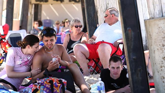 People sheltered from the heat under the Port Noarlunga Jetty earlier this month, when the mercury hit a record 44.7C in Adel...
