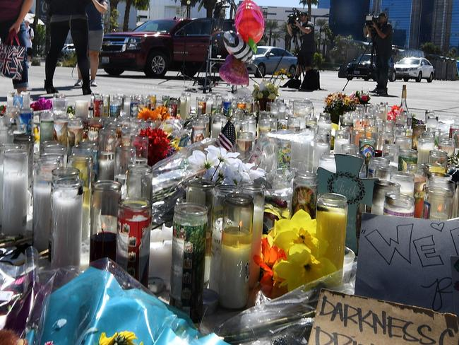 A makeshift memorial on the Las Vegas Strip pays tribute to those killed after Paddock killed 59 people and wounded more than 500 others. Picture: Mark Ralston/AFP