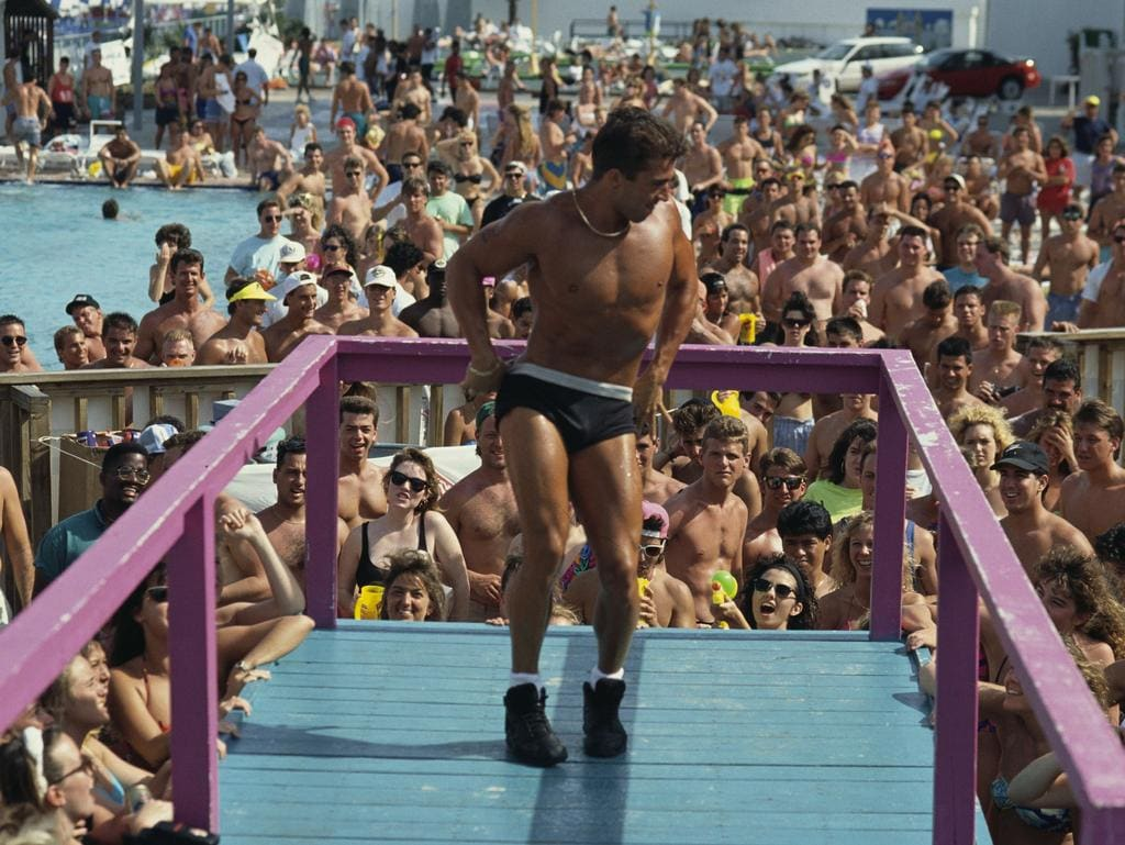 A young man lowers his underwear during a Spring Break competition in Daytona Beach. The winner of the strip contest will have the honor of pouring ice water on women during the wet t-shirt contest. (Photo by © Steve Starr/CORBIS/Corbis via Getty Images)