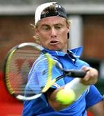 <p>Australia's Lleyton Hewitt returns a ball to Britain's Joshua Goodall on the first day of The Artois Championships at The Queen's Club in London.</p>