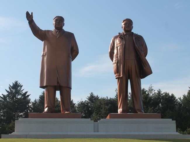 "Strange happenings ... The ""great leaders"", Kim Il Sung and Kim Jong Il, whose statues are everywhere in North Korea. Picture: Supplied."