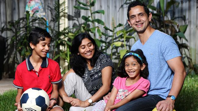 Rohit and Dola Bajpai with their children Rishi, 11 and Shefali, 7. The Bajpai family made the Big Switch. Picture: Carly Earl