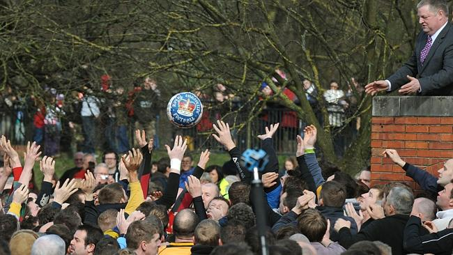 The ball is thrown into the crowd to start the Royal Shrovetide Football match in Ashbour