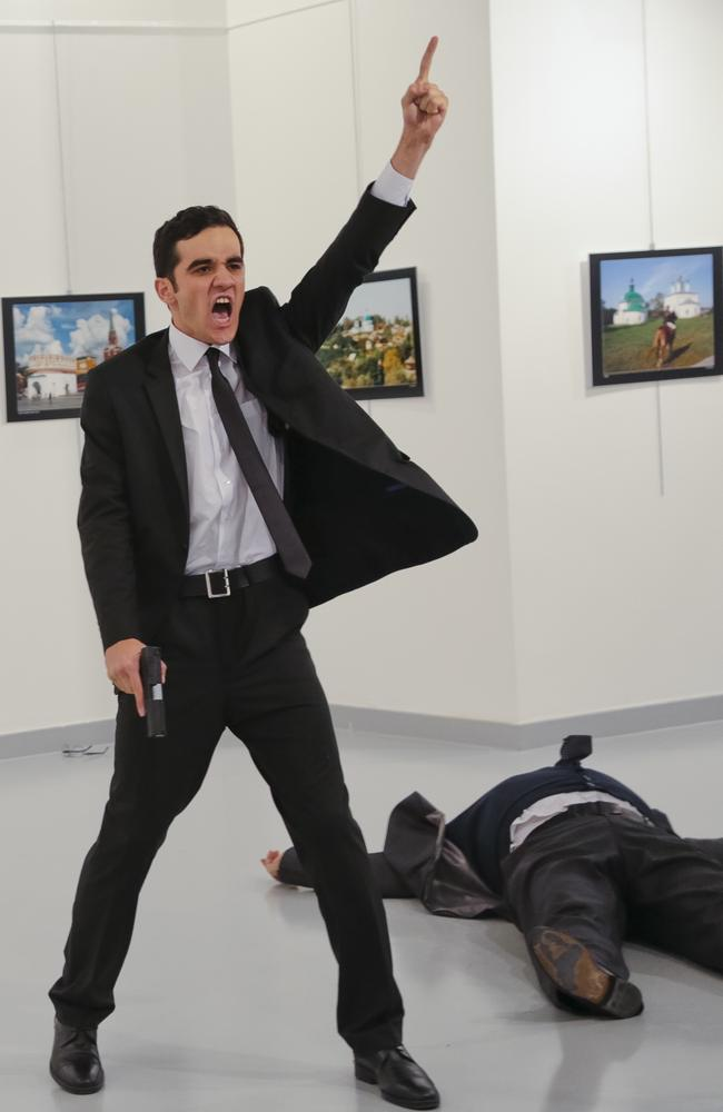 Turkish off-duty police officer Mevlut Mert Altintas (left) shot dead Andrey Karlov (right) the Russian ambassador to Turkey, at an art gallery in Ankara. Picture: AP Photo/Burhan Ozbilici