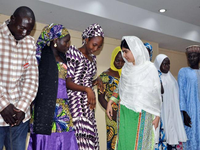 Campaigning ... Pakistani education activist Malala Yousafzai (centre) meets with five escaped Chibok school girls and parents of other abducted school girls in Abuja, Nigeria. Picture: Isaac Babatunde