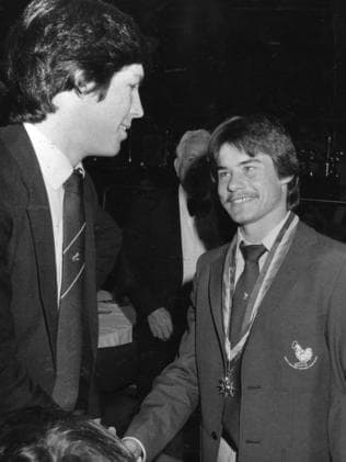 Tony Antrobus is congratulated by Stephen Kernahan after winning the 1983 Magarey Medal.