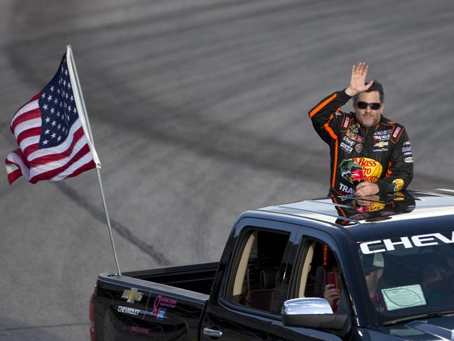 Tony Stewart waves to the crowd before the start of the race.