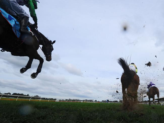 John Allen and Wells sit just off the pace as they clear one of the fences on the first lap. Picture: Getty Images