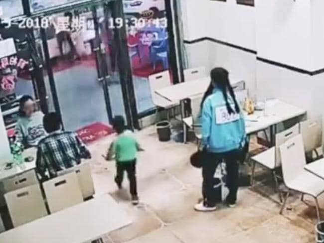 The woman tripped the boy as he left the restaurant. Picture: YouTube