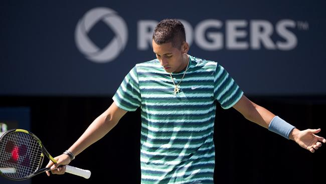 Nick Kyrgios of Australia gestures in frustration.