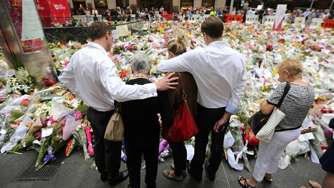 Streams of people left flowers at the memorial for victims Tori Johnson and Katrina Dawson in Martin Place in the days following the siege. MS Dawson's family visited the site three days after the tragedy. Picture: John Grainger.