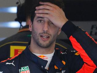 Red Bull's Australian driver Daniel Ricciardo reacts in the team garage during the Formula One Australian Grand Prix on March 26, 2017. / AFP PHOTO / POOL / BRANDON MALONE / --IMAGE RESTRICTED TO EDITORIAL USE - STRICTLY NO COMMERCIAL USE--
