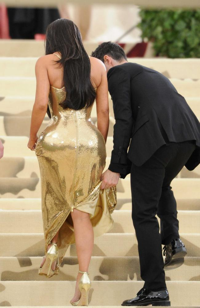 Kim Kardashian, pictured in Versace at the Met Gala in New York this week, has never admitted to a bum enhancement. Picture: MEGA