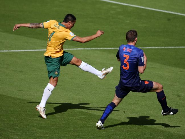 Australia's Tim Cahill strikes the sweetest of volleys against the Netherlands at World Cup 2014.