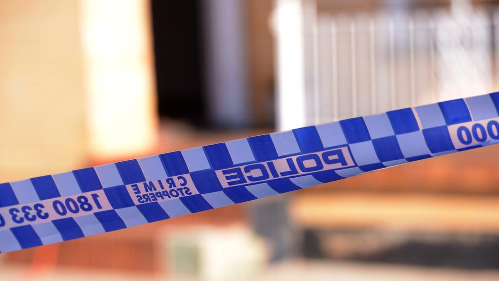 A man has been arrested after he allegedly bit off parts of another man's ears at Murray Bridge last night.