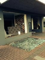 The wind was so strong it blew out a window of Hali Rugs in Glen Osmond. Picture: Matthew Gaffney