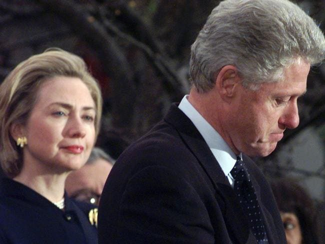 Standing by her man ... Then First Lady Hillary Rodham Clinton watches President Bill Clinton pause as he thanks those Democratic members of the House of Representatives who voted against impeachment in 1998. Picture: AP