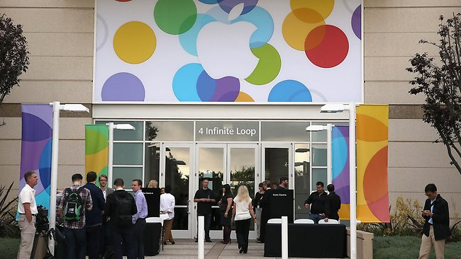 People arrive for an Apple product announcement at the Apple campus. Picture: AFP