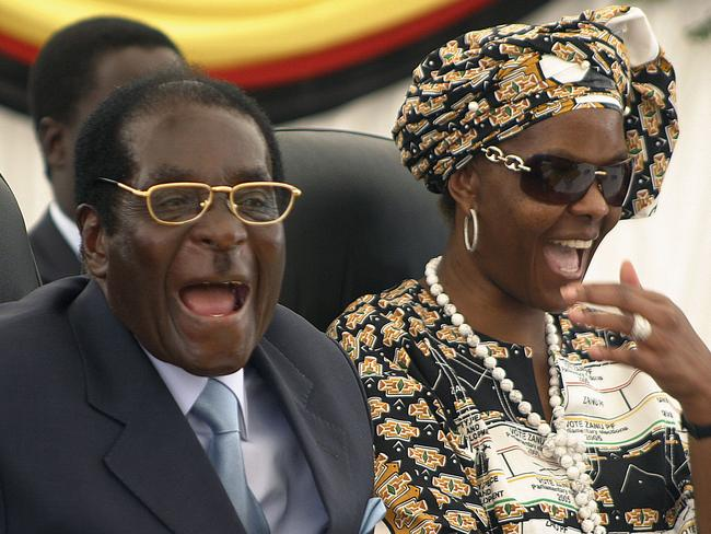 FRobert Mugabe and his wife, Grace, are out in Zimbabwe. Picture: AP