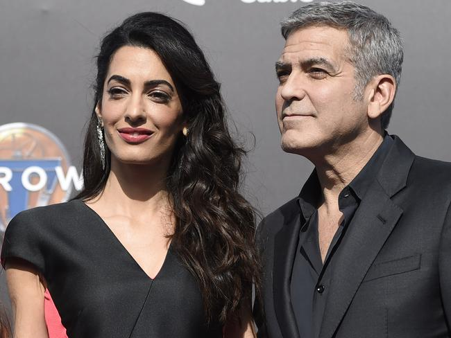 "George and Amal Clooney at the world premiere of ""Tomorrowland"" on Saturday, May 9, 2015. (Photo Chris Pizzello/Invision/AP)"