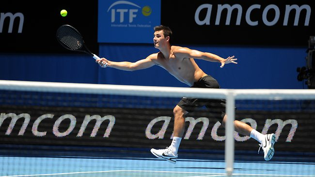 Bernard Tomic practicing at Perth Arena ahead of the Hopman Cup. Picture: Richard Polden