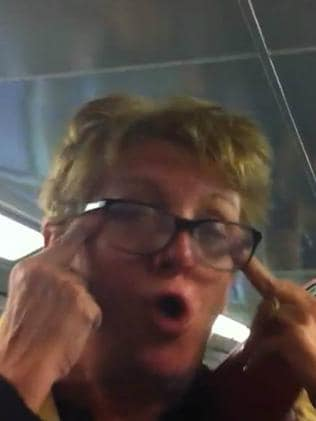 "Karen Bailey pulls the sides of her eyes as she abuses as Asian woman, calling her a ""gook"". Picture: Video still from YouTube"