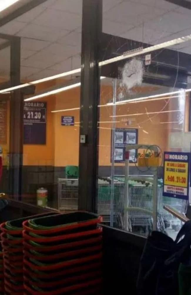 A bullet hole in glass at the supermarket. Picture: Twitter