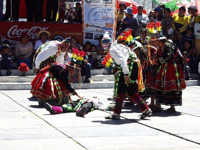 A competitor is down for the count during Tinku in Bolivia. Picture: Marc Davis