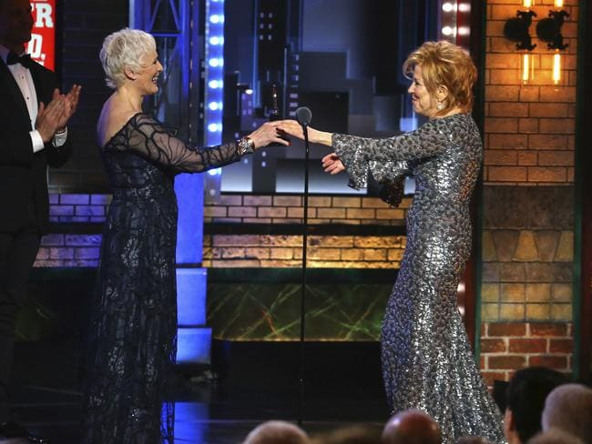 "Glenn Close, left, presents the award for best performance by an actor in a leading role in a musical to Bette Midler for her role in ""Hello, Dolly!"" at the 71st annual Tony Awards. Picture: AP"