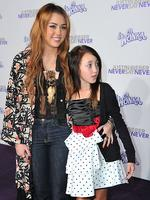 <p>What's that on your chest ... Actress and singer Miley Cyrus, wearing a boho chic Winter Kate by Nicole Richie ensemble and a Marilyn Hammer racoon skull necklace, with younger sister Noah Cyrus at the premiere of Paramount Pictures' Justin Bieber: Never Say Never at Nokia Theater L.A. Live on February 8, 2011 in Los Angeles, California. (Photo by Alberto E. Rodriguez/Getty Images for Paramount Pictures)</p>