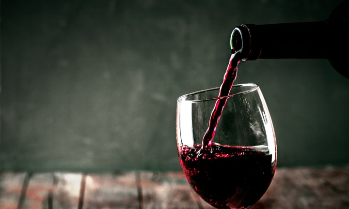 Red wine. Glass of wine. Pouring red wine.