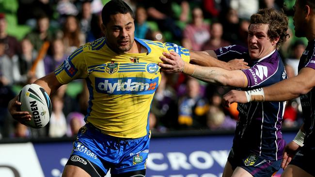 Jarryd Hayne pushes away from Kurt Mann to make a break for the Eels.