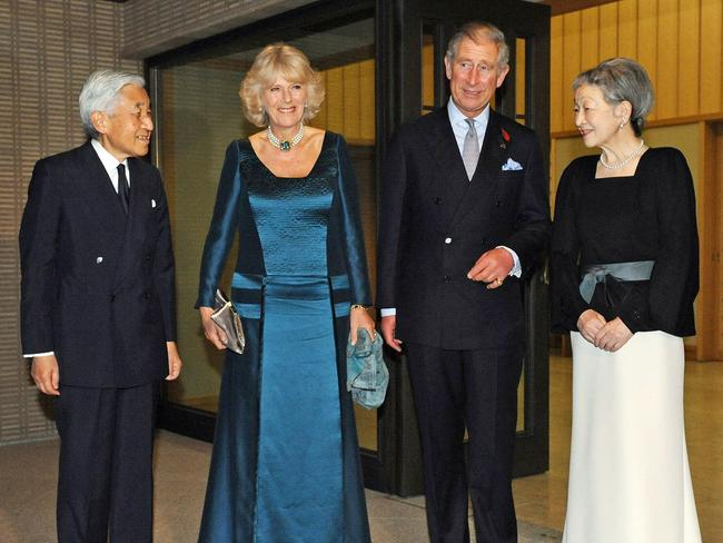 Visiting British Crown Prince Charles and his wife Camilla (2nd L) are greeted by Japanese Emperor Akihito and Empress Michiko for a dinner at the Imperial residence in Tokyo, 2008.