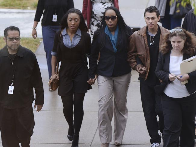 Ina Rogers, centre, walks to Solano County Superior Court in Fairfield, California. Picture: AP