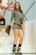 <p>Erin McNaught, Miss Australia 2006, introduces herself in her national costume.</p>  <strong>Designers rate this year's outfit</strong>