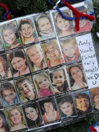 Tragedy ... Photos of Sandy Hook Elementary School massacre victims sits at a small memorial near the school in Newtown, Connecticut. Picture: John Moore, Getty Images/AFP