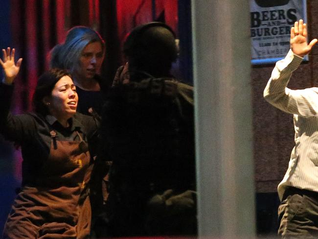 Harriette is seen fleeing the scene with other hostages. Picture: Rob Griffith
