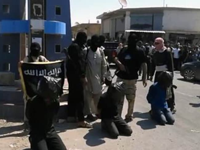 Public execution ... the ISIS video purports to show three men lined up and killed in the centre of Slouk.